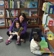 Horwitz reads with her daughter