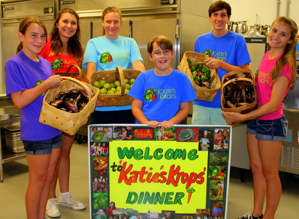 Kids volunteering at a Katie's Krops Dinner