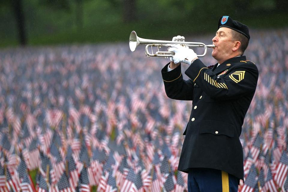"SFC Robert Bean plays ""Taps"" on the Common at the MMHF Memorial Day event.  (photo credit: Pat Greenhouse/Boston Globe Staff)"