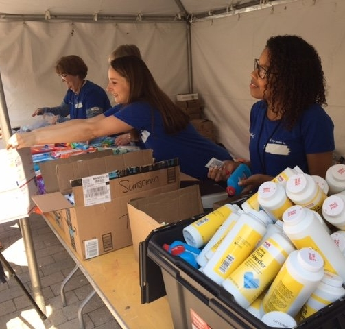 Volunteers putting together care packages.  (photo credit: Shira Schoenberg)