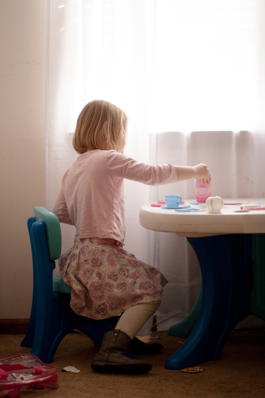 Little girl having a tea party