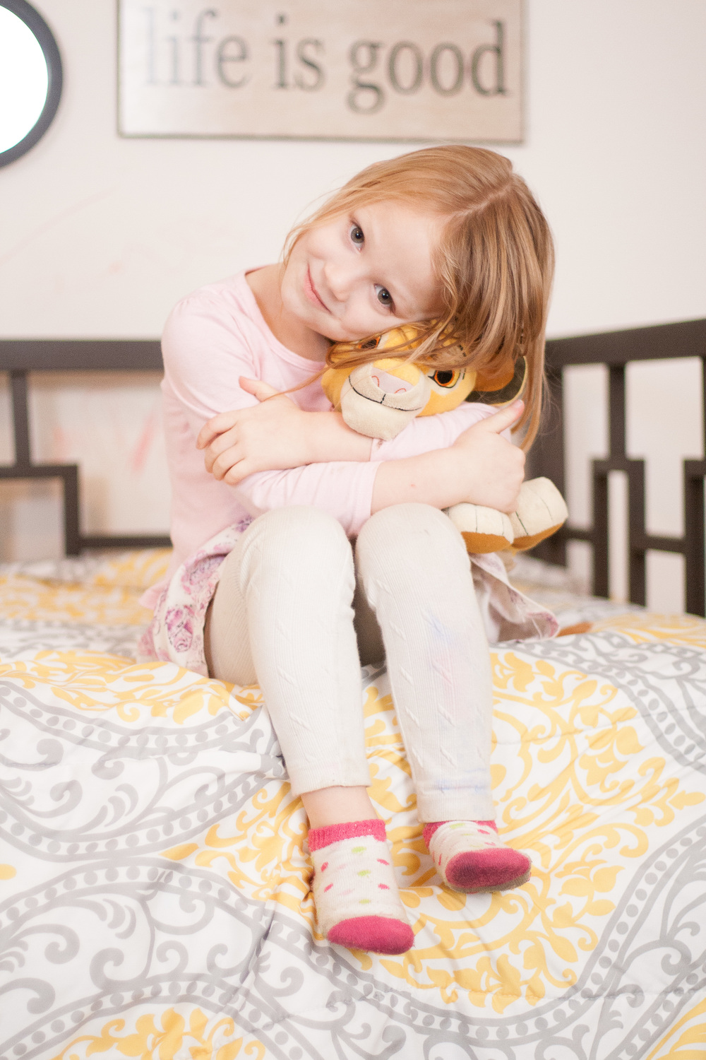 Candid Child snuggling stuffed animal