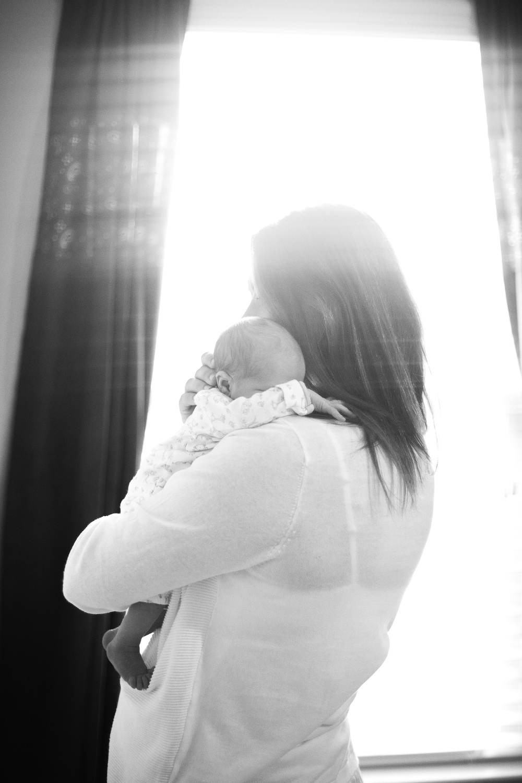 Mom cuddling newborn baby