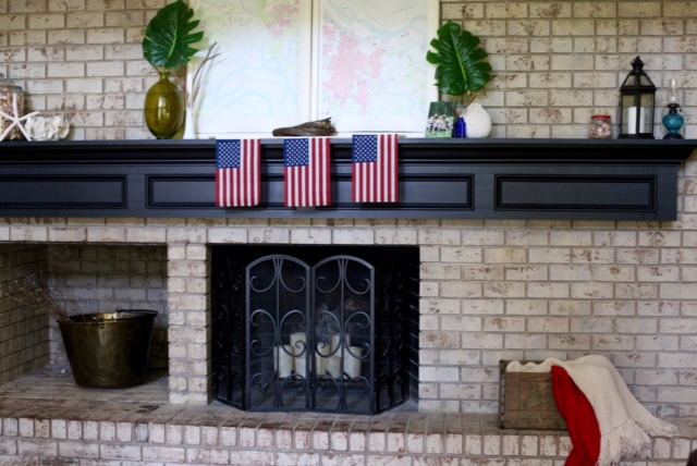 In case you are wondering how I hung those American Flags...tape!  I know I know...like I said, I'm not an interior designer people!