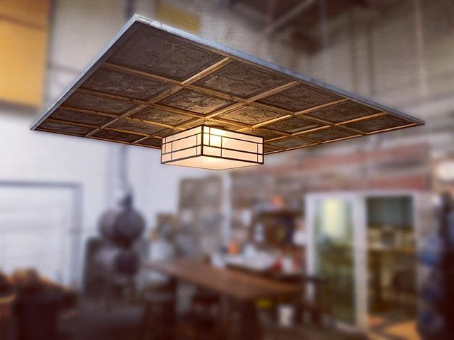 A little facelift for our common area at the shop. Cloud made from salvaged tin ceiling tiles. Light fixture made in-house. We fancy now, y'all. . . . . . #woodworking #reclaimedwood #ilovewoodworking #custommade #furniture #customfurniture #anythingwoodandmetal #handmade #baltimore #sustainablymade #baltimorebuilt #maker #interiordesign #ceiling #lighting