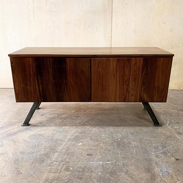 Just wrapped up this sexy little number for our friends @arrisdesign @pricemodern and @cybrary.it 😍 walnut credenza with raw steel accents to match the big mama 14' conference table. Pics of that babe coming soon. . . . . . #woodworking #reclaimedwood #ilovewoodworking #custommade #furniture #customfurniture #anythingwoodandmetal #handmade #baltimore #sustainablymade #baltimorebuilt #maker #interiordesign #commercialrealestate #commercialdesign