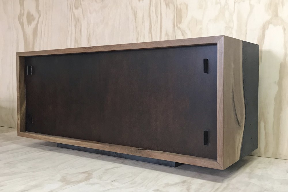 walnut v concrete | credenza {71x35x24}  rusted steel sliders inside this Harlan inspired wood v concrete box