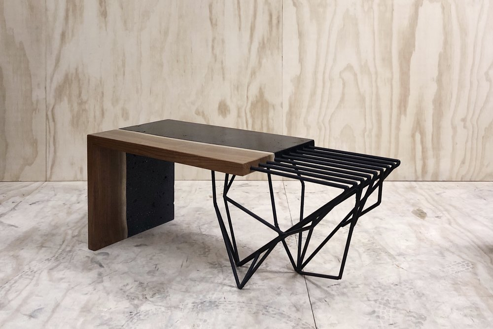 walnut v concrete waterfall coffee table.   string theoried steel supports. [37x16x16]