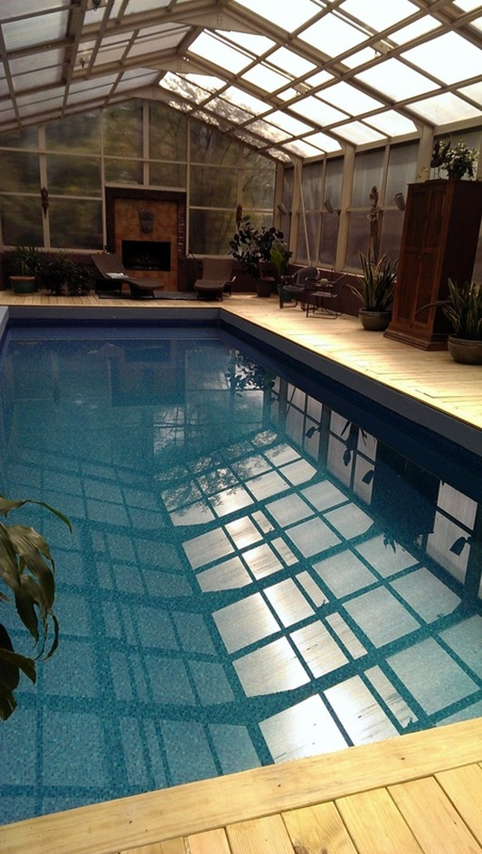 Heated pool, fireplace, retractable ceiling: i want to live here.