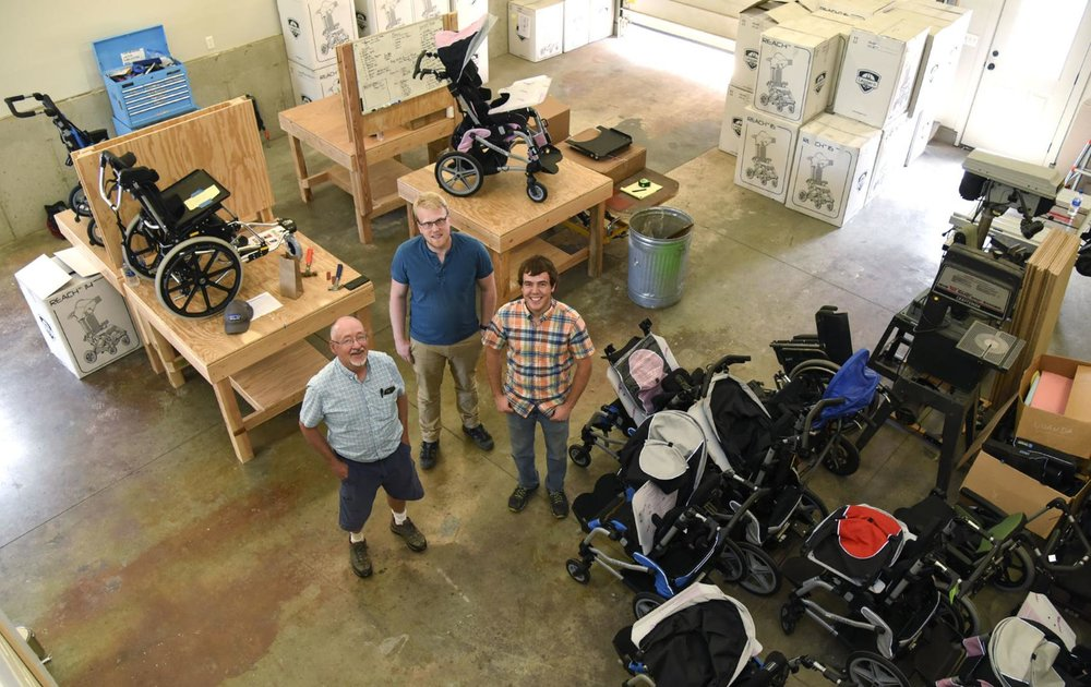 ROC Wheels co-founder Wayne Hanson, left, and two interns, Karl Swenson and Robert Knutson, stand in the middle of the nonprofit's new headquarters on Thursday, May 31, 2018, in Four Corners