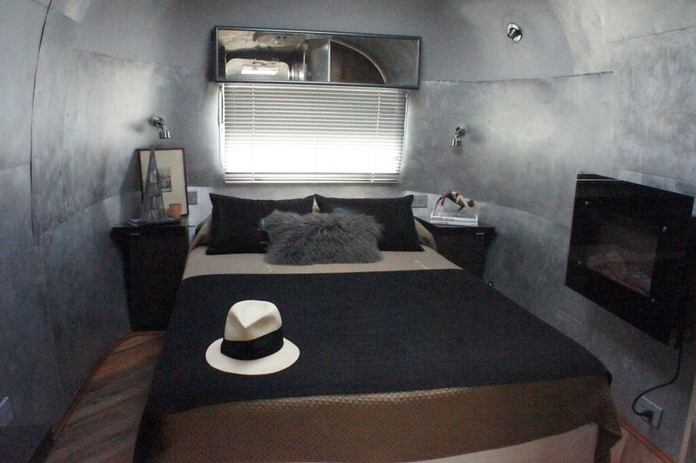 Master Bedroom Suite features flatscreen television, electric fireplace and closet storage