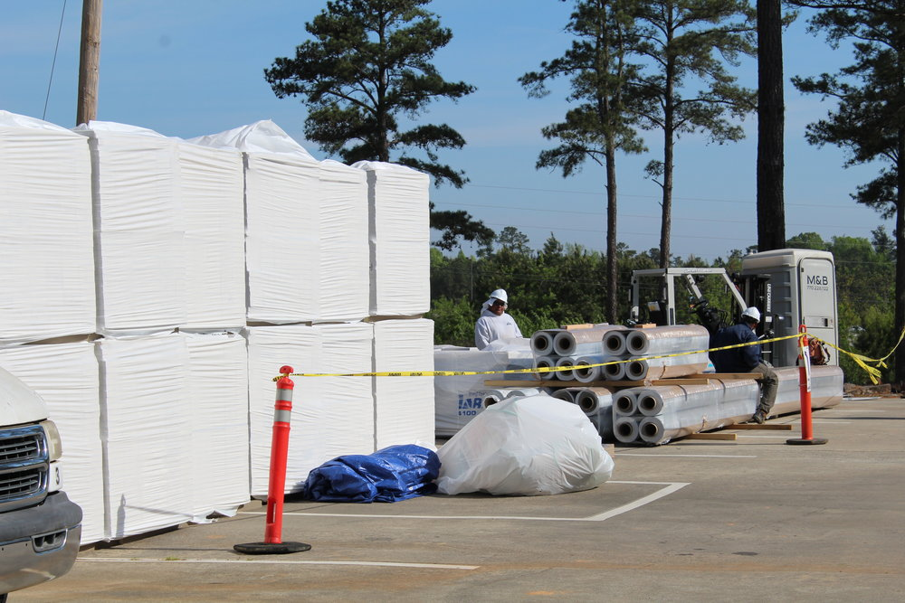 Loads of roofing material being prepared to make their way to the top of the PreK building for repairs. Some of this material will also fix some of the problem leaks on the Elementary building.