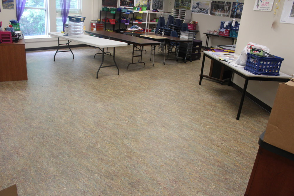 Let's not forget the new flooring in the Art room... no more paint in the carpet.