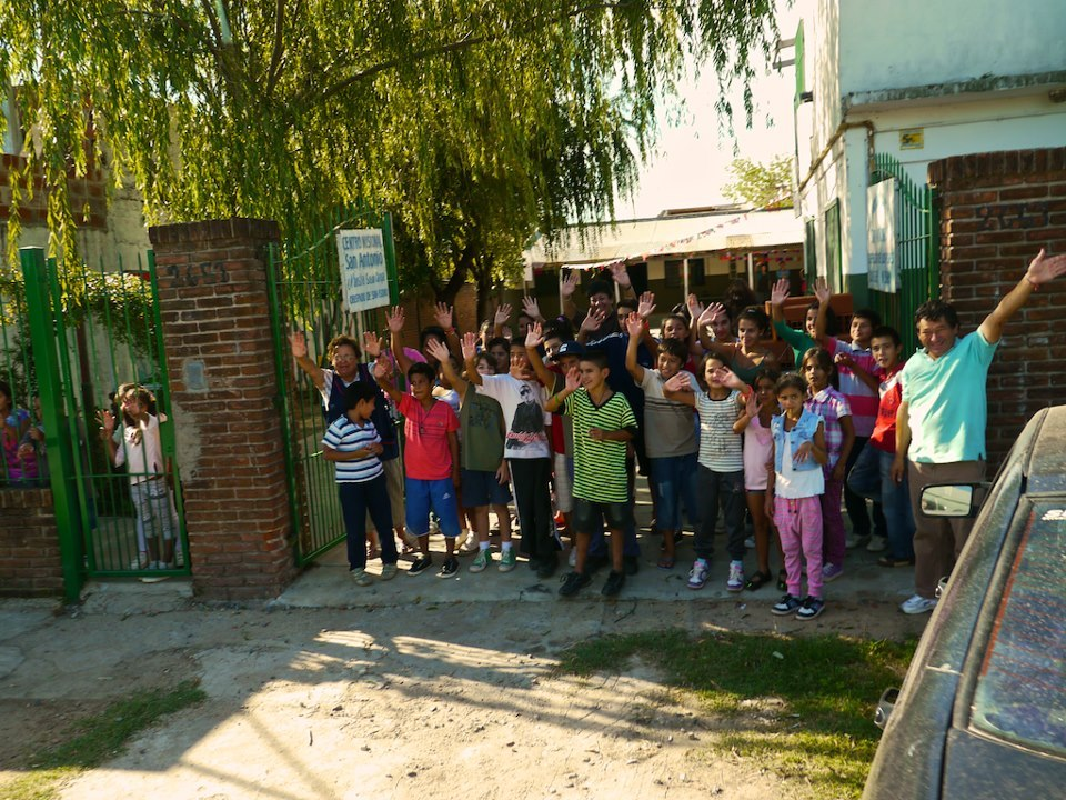 The children at the school in Le Tigre waving goodbye to the Roadmonkeys after their project is complete and they are homeward bound.