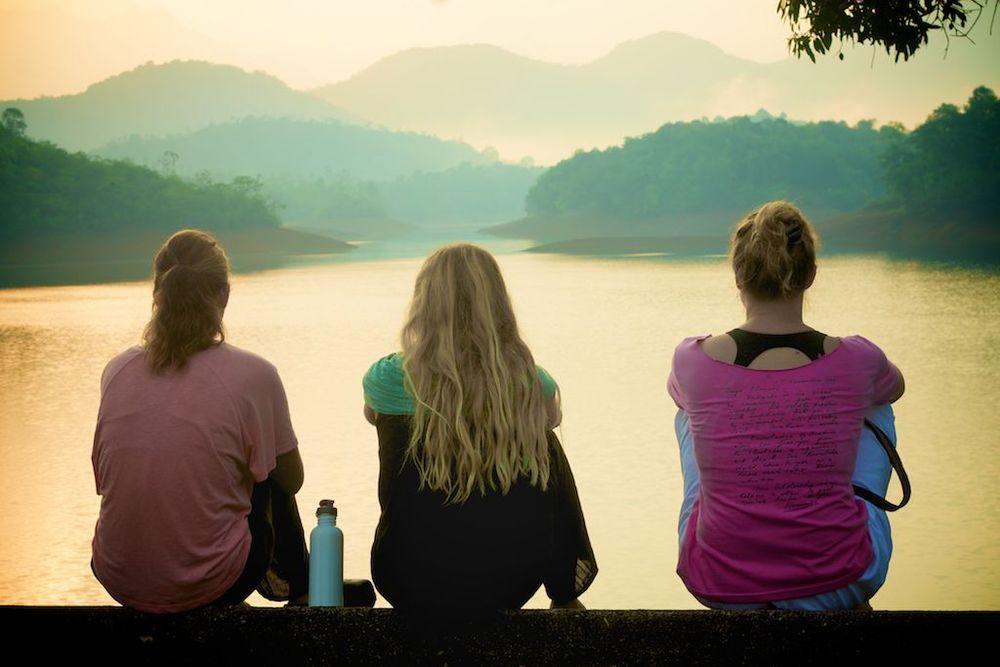 Emi, Lauren, Kate…catching sunrise over the lake.