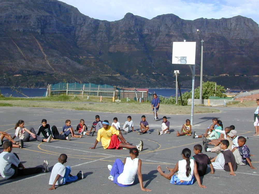 Stretching it out in a circle with All Star coach. Hout Bay, Cape Town