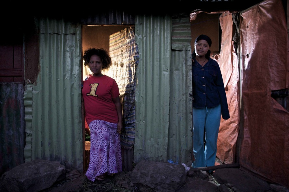 "Weinit, 24, (left) and Busunesh, 27, (right), escaped from the same village in Ethiopia a decade after being sold into marriage by their families, only to fall into commercial sex work in the ""Merkato"" neighborhood of Addis Ababa, Ethiopia's capital."