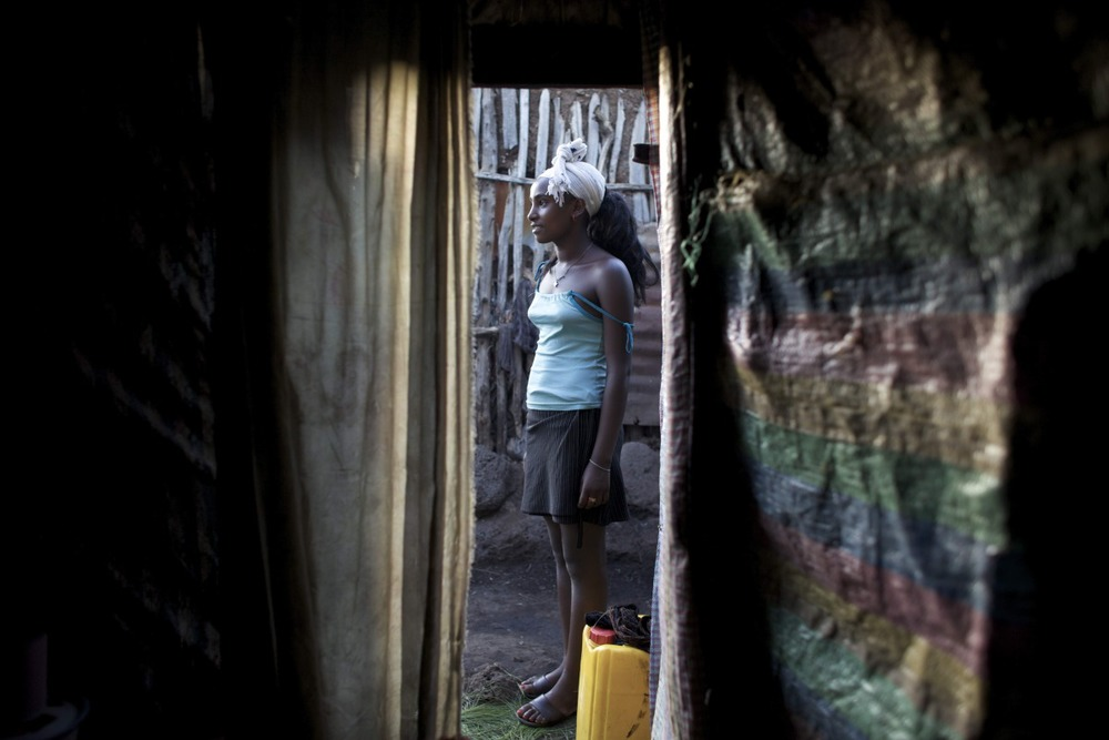 Agare' stands outside the shack where she works as a commercial sex worker while waiting for clients in the center of the city of Bahir Dar, a commercial hub in the Northern Amhara region of Ethiopia.