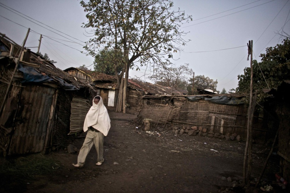 A man walks through the neighborhood of Bahir Dar where commercial sex workers wait for clients night and day, in the Northern Amhara region of Ethiopia.