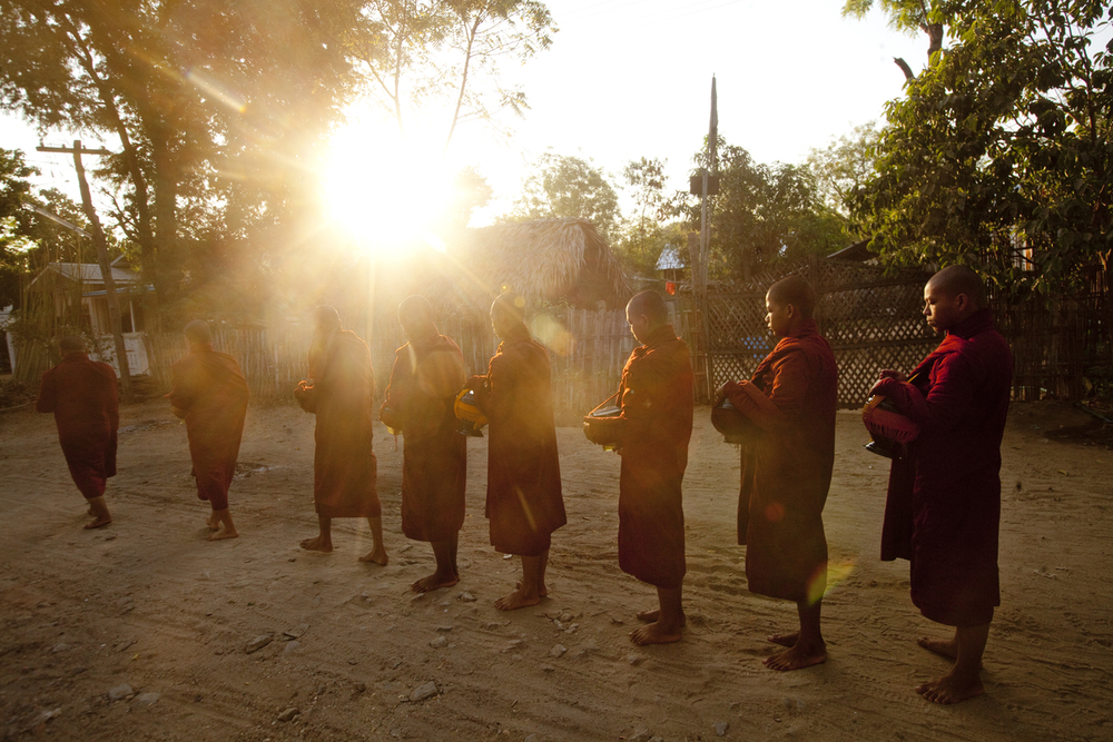 A group of novice monks pass through Bagan to collect offerings.