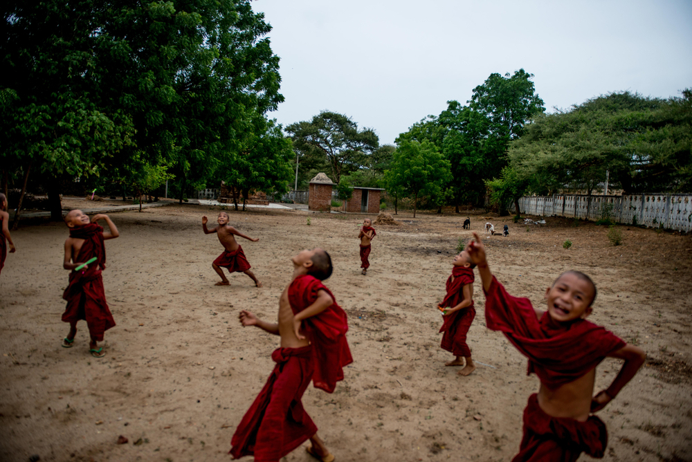 Novice monks play with new toys at a small monastery in Bagan.