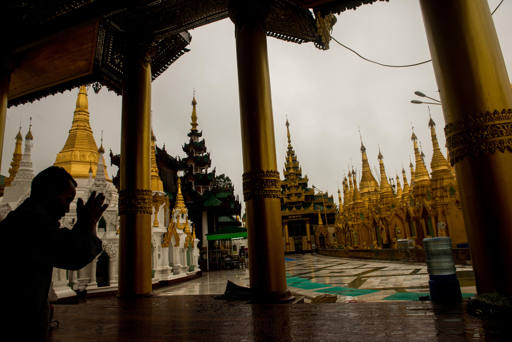 Man prays at Shwedagon Pagoda Yangon (Great Dragon Pagoda).