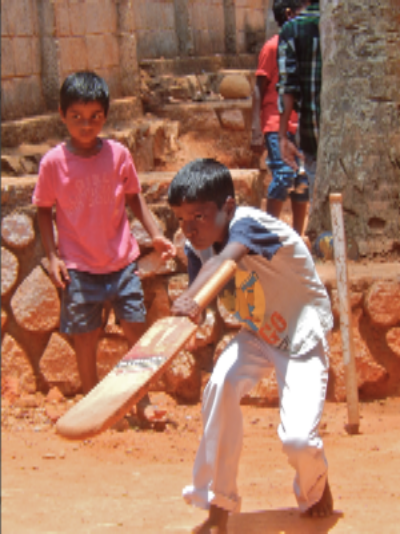 Kids play cricket during recess at SISP