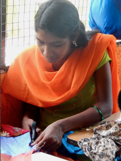 Young girl works in craft centre which provides employment opportunities