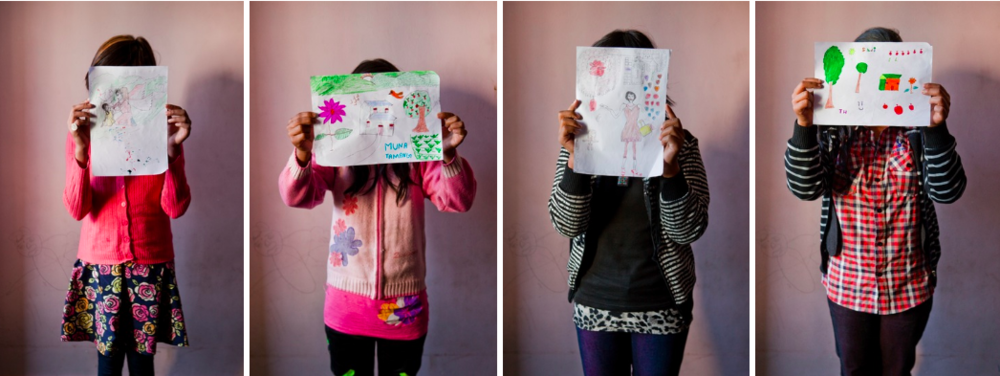 "Young sex trafficking survivors at the Shakti Kendra shelter in Kathmandu, Nepal holds up their favorite drawings. From left to right, ""an angel helping a girl in need"", ""an imaginary house"", ""going shopping"", ""a house in the mountains"" (Photographs: Katie Orlinsky) Kathmandu, Nepal"