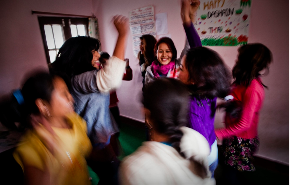 Young residents dancing at the Shakti Kendra shelter. (Photograph: Katie Orlinsky) Kathmandu, Nepal