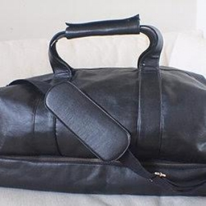 The Weekender Bag, £800 [$1006 USD]