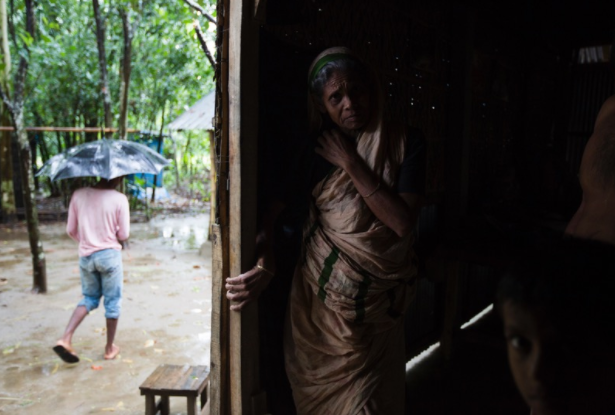 An old lady inside her home, which has no running water or electricity, in Dayuti enclave.