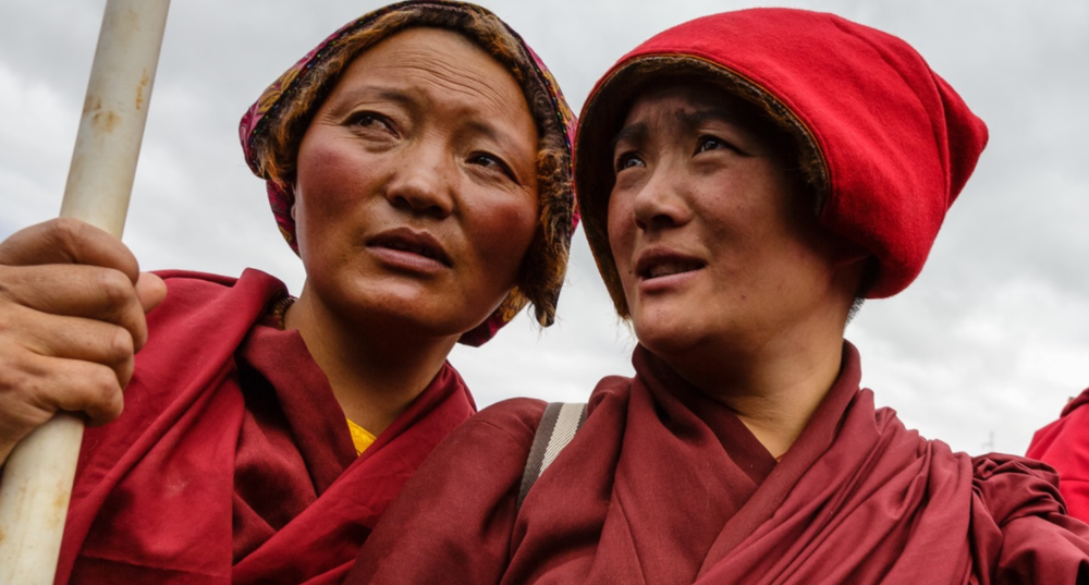 Nuns at a ceremony at Yarchen Gar in which almost the entire population of the camp leaves for a month of meditation in the surrounding hills.