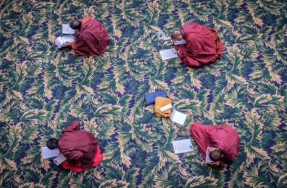 Monks in study and debate at Larung Gar.