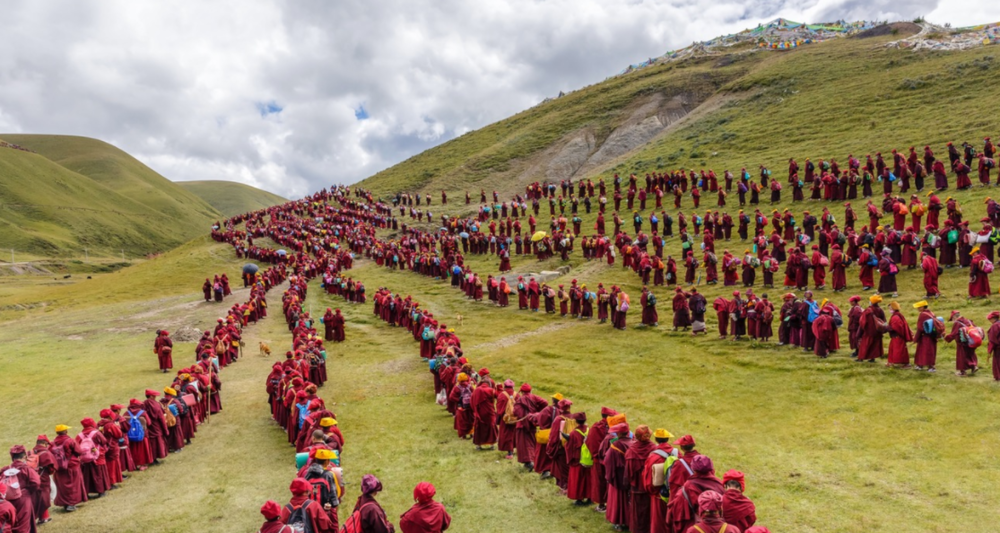 The nuns of Yarchen Gar prepare to walk into the hills for a month of meditation.