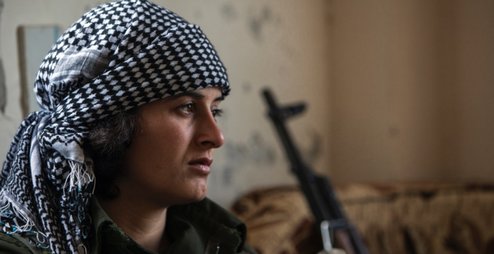 Portrait of a young Kurdish YPJ fighter.