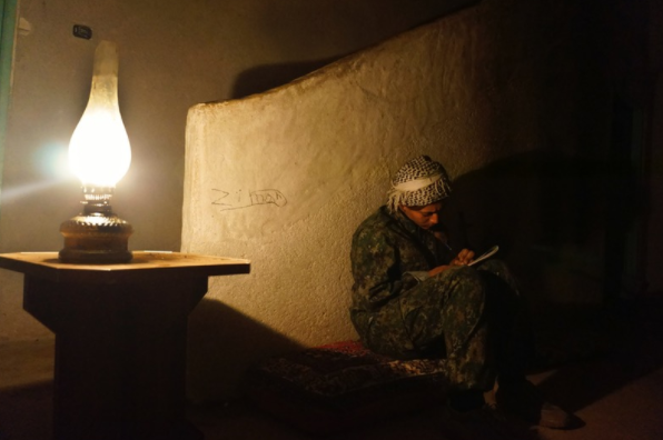 26 March 2015, Roonahit, a YPJ fighter prepares dinner for the fighters in Baghdak village.