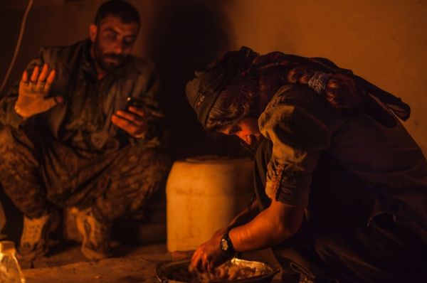 27 March 2015, newly joined YPJ fighter writes her diary by gas light in Baghdak village.