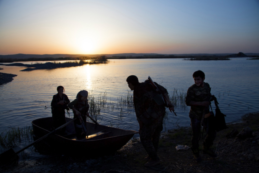 A group of YPJ and YPG fighters crossing the Euphrates‎ river on the western front-line near Kobanî.