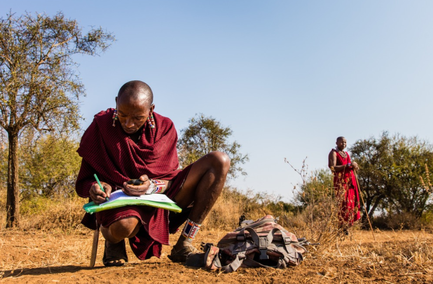 Lion Guardian Kamunu Saitoti takes meticulous notes about his observations, including GPS readings of animal tracks.