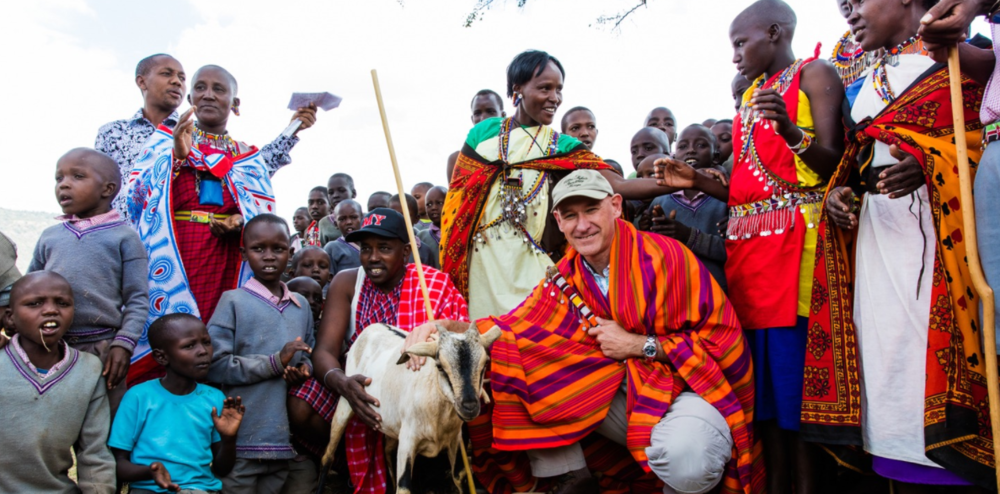 Calvin Cottar is presented with a goat as a token of appreciation for building Olpalagilagi Primary School, as well as funding salaries and meals. In the long run, the hope is that land lease fees will enable locals to fund their own projects, bringing greater autonomy.