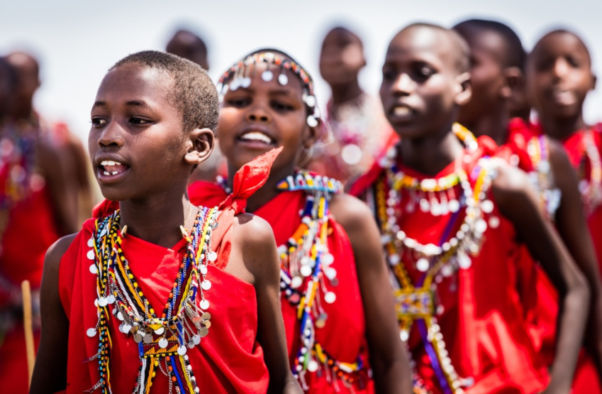 Local schoolchildren perform a traditional Maasai dance to open proceedings at a meeting hosted by Olpalagilagi Primary School.
