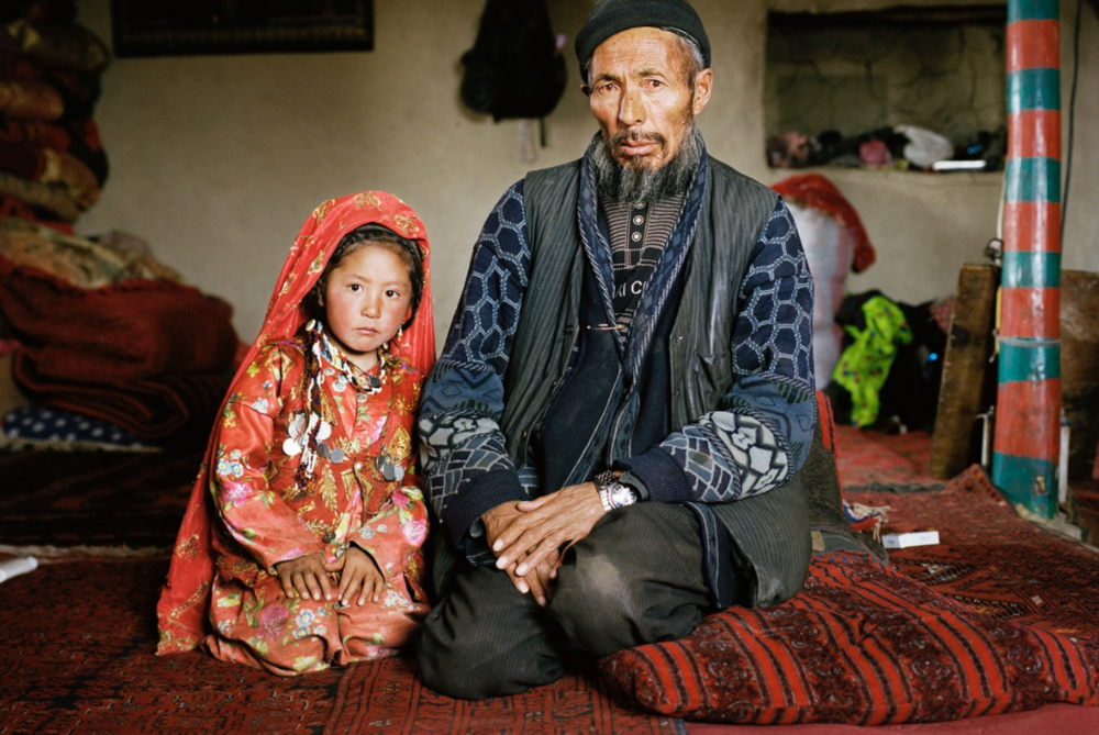 A Kyrgyz father and his daughter in their home. Chalab, Lake Chaqmaqtin.