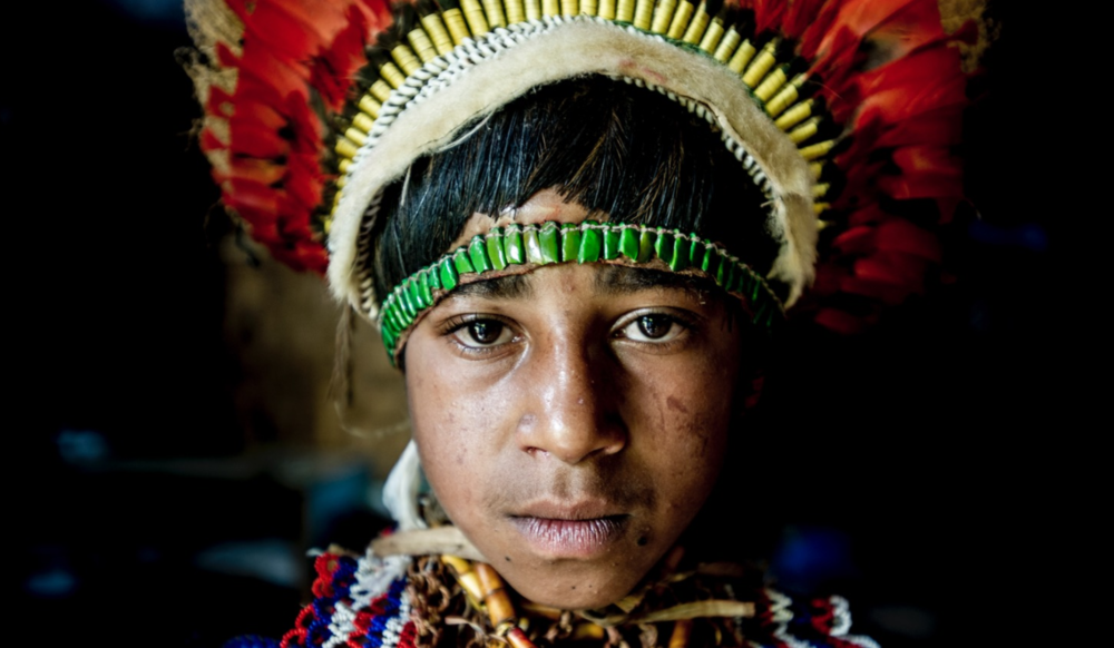 Vegu, a member of the Nagamiufa tribe in the eastern highlands of Papua New Guinea, wearing traditional 'bilas'. Her grandfather receives a small living allowance from the government for his work preserving traditional costumes from the highlands.