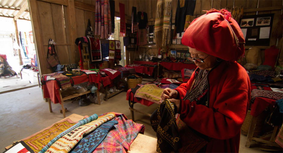 An elderly Red Dao woman embroiders traditional handicraft now popular with tourists. One of the challenges the CBT Vietnam project has tried to tackle is reducing the number of street sellers following tourists. By promoting the creation of new markets, the hope is to have local sellers stop following tourists and instead have a fixed area where they can offer their goods.