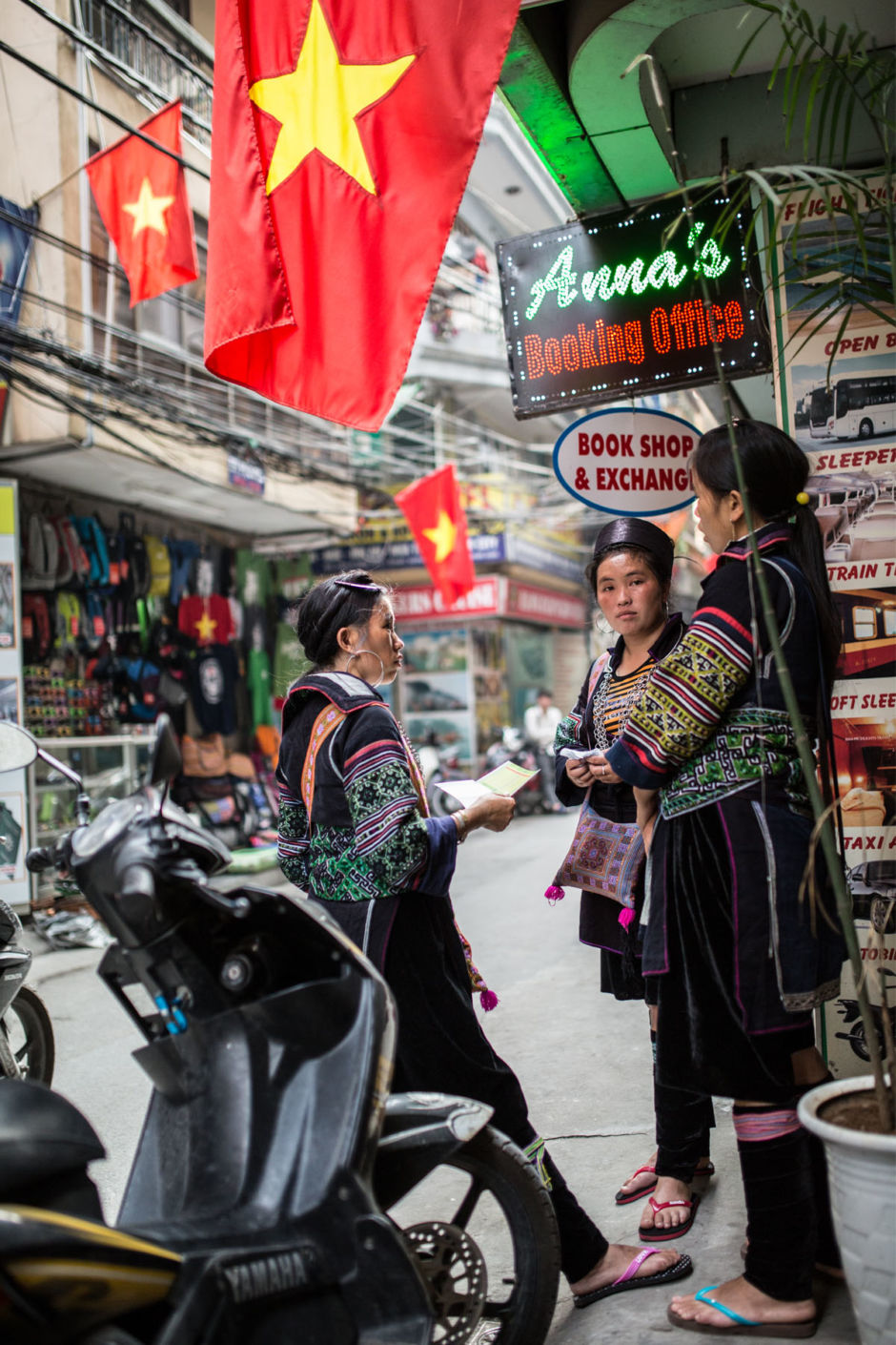 A group of Black Hmong women prepare to network with tour operators in Hanoi. They are small business entrepreneurs running homestays, embroidery shops, and herbal baths, and on this trip, are hoping to build connections in Hanoi.