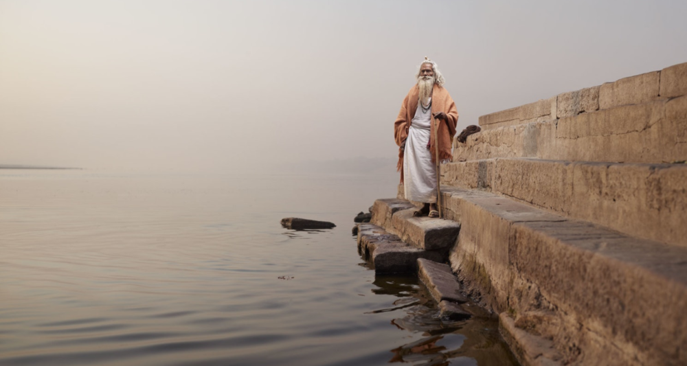 Baba Vijay Nund on the steps of Chet Singh Ghat on the banks of the Ganges River.