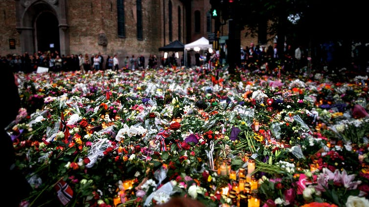 Flowers and candles in Oslo after the 2011 Norway attacks. Henrik Lied / NRK/flickr