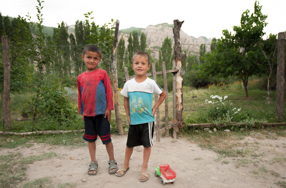 Boys play outside before the fast breaks at sunset for the evening Ramadan feast.