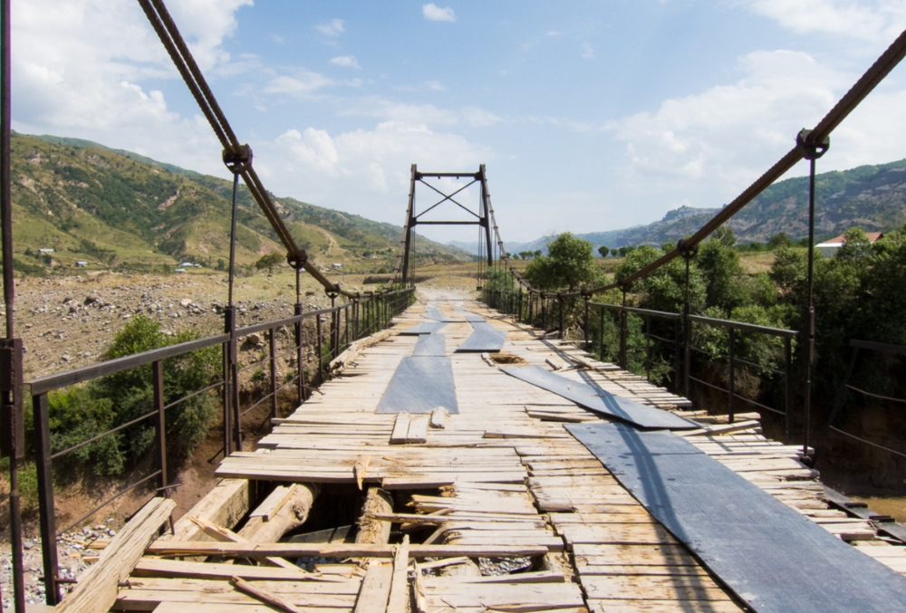 Broken bridges and roadways because of the heavy mining machinery traveling through the area.